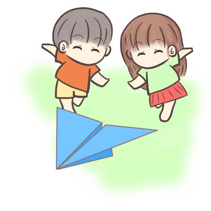 紙飛行機を追いかける子供たち