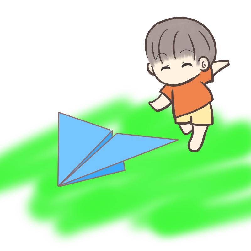 紙飛行機を追いかける男の子