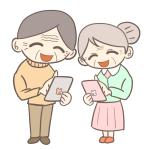 スマホを操作するおじいさんとおばあさん